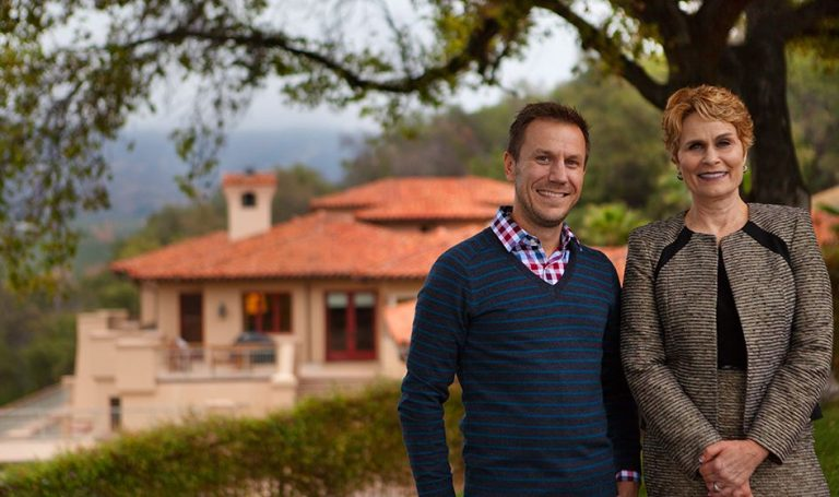 Photograph of Mary Pizzimenti and John LaRosa, mother and son, REALTORs, Brokers, and the Owners of PHA Realty, a California Real Estate Brokerage, pictured here at their client's home in Ojai, California