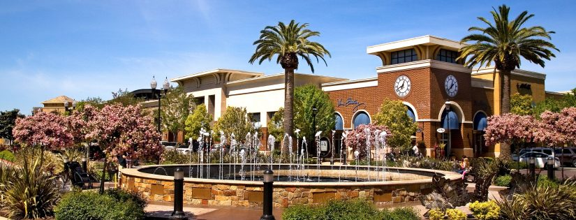 Shoppers enjoy The Fountains outdoor shopping complex in Roseville, California on a clear sunny day